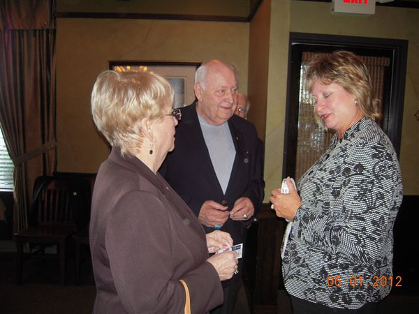 Rotary Club Wine Tasting Event on June 1, 2012:<br /> President, Karen Wegrzyn speaking with guest from the Orland Park Rotary Club.
