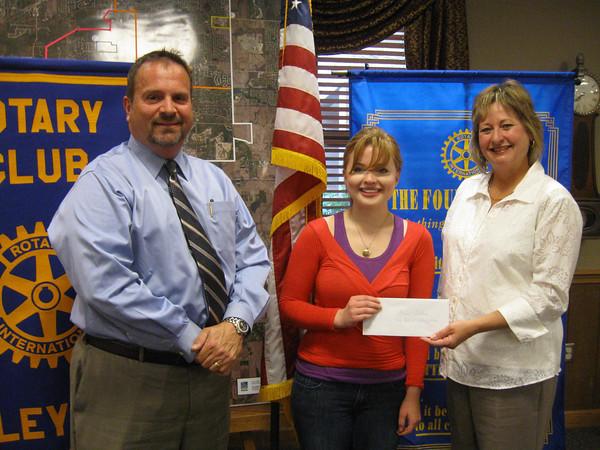 Tinley Park High School graduate Rachel Gattone accepts a $1,000 scholarship from Tinley Park-Frankfort Rotary Club member Dennis Platipodis and President Karen Wegrzyn.