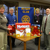 "Tinley Park-Frankfort Rotary assists families victimized by domestic violence...<br /> <br />    A number of families victimized by domestic violence will receive some essential services, such as food, thanks to a donation by the Tinley Park-Frankfort Rotary club.<br /> <br />    The Rotary, which strives to help those less fortunate, donated $1,100 worth of gift cards to the Crisis Center of South Suburbia.<br /> <br />    ""Each year, the Tinley Park-Frankfort Rotary Club provides assistance to local organizations, in addition to our international efforts such as polio eradication. We are extremely proud of our efforts to support the Crisis Center, knowing that we are helping people right here in Tinley Park,"" commented Karen Wegrzyn, President of the Tinley Park-Frankfort Rotary Club.<br /> <br />    The Rotary club, which includes business leaders, educators and clergy from the Tinley Park and Frankfort area, sold poinsettias during the holidays to raise funds for the Crisis Center.<br /> <br />    Proceeds from the poinsettia sale were used to purchase gift cards to Costco, a wholesale membership warehouse that sells everything from food to personal hygiene items. The warehouse kicked in some additional assistance by donating diapers, talking Elmo dolls, two free membership cards and a $50 gift card of its own.<br /> <br />    ""Your donation will help feed 40 people for 3½  months,"" Edward Vega, the crisis center's executive director, told Rotarians as he accepted their $1,100 worth of gift cards Thursday (Jan. 29).  ""That is what your time and investment means.""<br /> <br />    The Crisis Center is the only non-profit community organization in the south suburbs that provides emergency shelter and other essential services to individuals and families victimized by domestic violence.<br /> <br />    Vega estimates the shelter helps between 30,000 and 40,000 people each year, providing everything from counseling and court advocacy to family case management and emergency short-term shelter.<br />   <br />    The Crisis Center can house up to 35 women and children for up to 60 days, said Vega. He added the organization depends on private donations to fund half of its $2 million budget each year.<br /> <br />    ""We are very, very grateful (for your help),"" he told the Tinley Park-Frankfort Rotary."