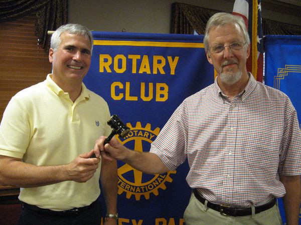 "Changing of the Guard:<br /> Tinley Park-Frankfort Rotary Club installs new president.<br /> <br />    A new leader has stepped forward to guide the Tinley Park-Frankfort Rotary Club in its mission to serve others and to make the world a better place to live.<br />  <br />    Paul Lyons, president and co-owner of Home Helpers in New Lenox, was installed Thursday, June 24, as president of the Tinley Park-Frankfort Rotary Club. He replaces Steve Purucker who stepped down from the post at the end of June.<br /> <br />    ""I am proud to be a Rotarian,"" said Lyons. ""Their motto of `Service Above Self"" means a lot to me.""<br /> <br />     ""I will always be proud to tell people that I was a Rotary Club president,"" said Purucker, who was the driving force behind the group's dictionary project with Harvey School District 153. ""We did a lot of good things over the past year, and I'm happy to say that I leave a strong club.""<br /> <br />    Lyons, who lives in Mokena with his wife, Vicki, said he looks forward to continuing the traditions that Purucker started and creating his own. <br /> <br />    ""It's going to be a challenge,"" he said. ""But I'm looking forward to it. I have some very good mentors here.""<br /> <br />    Even though he will no longer be Rotary president, Purucker plans to remain actively involved in the group as its Membership Chairman and a member of its Executive Board.<br /> <br />    As a thank you for his service, Rotarians purchased a commemorative brick with Purucker's name on it that will be installed in the Paul Harris Commemorative Walkway at the Mount Hope Cemetery near the southern edge of Chicago. Paul Harris was the founder of Rotary.<br /> <br />     ""Rotary is a great organization,"" said Purucker, ""and I appreciate that you all donate time, energy and money to the cause."""