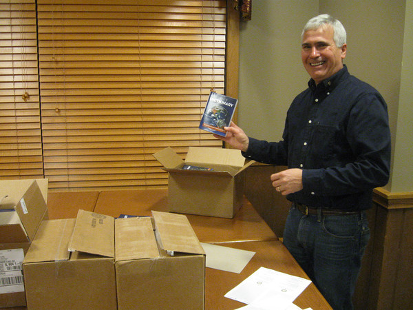 Tinley Park-Frankfort Rotarian Steve Purucker holds up one of the dictionaries that the club donated to every third-grader in the Harvey School District this year.