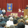 Tom Lemming of College Sports TV (CSTV) congratulates the Top 10 percent of graduating seniors from Tinley Park, Andrew, Lincoln-Way East and Lincoln-Way North high schools during a Top 10 Gala sponsored by the Tinley Park-Frankfort Rotary Club on March 14. Lemming encouraged students to follow his six rules for success: preparation, organization, contacts, time management, respect and passion.