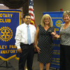 "Changing of the Guard:<br /> Tinley Park-Frankfort Rotary Club installs new president<br /> <br /> A new leader has stepped forward to guide the Tinley Park-Frankfort Rotary Club and to raise awareness about its global, national and local efforts.<br /> <br /> Margaret Semmer, a Mokena resident and parent of two students at Lincoln Way East High School, was installed July 12 as president of the Tinley Park-Frankfort Rotary Club. She replaces Karen Wegrzyn who completed her third, one-year term in June.<br /> <br /> ""I'm looking forward to continuing the efforts of the Tinley Park-Frankfort Rotary to offer scholarships to local high school students while expanding our work to serve the community,"" said Semmer, an experienced community college educator, currently serving as Vice Chancellor of Academic Affairs at Ivy Tech Community College, Northwest Indiana.  <br /> <br /> Pictured: Karen Wegrzyn (far right), past president of the Tinley Park-Frankfort Rotary Club hands the gavel over to newly elected president, Margaret Semmer, and president-elect, Jan Paul Ferrer."