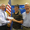 Andrew High School graduate Kevin Hendzel accepts a scholarship check from Tinley Park-Frankfort Rotary Club Treasurer Sean Brady (left) and Rotary Club President Paul Lyons.