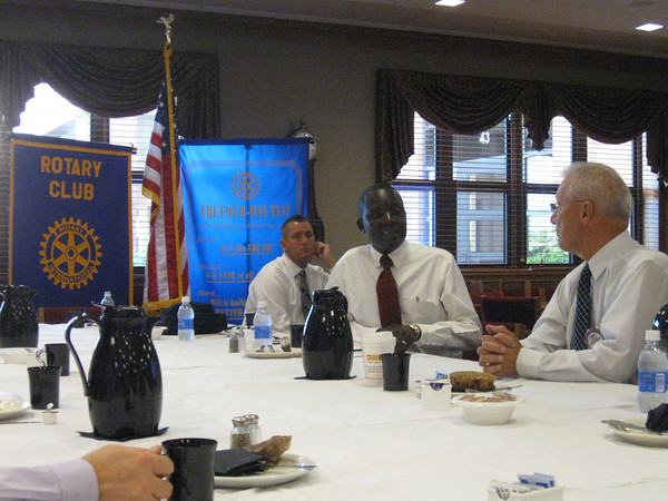 Ugandan educator Robert Nabulere talks to the Tinley Park-Frankfort Rotary Club on Aug. 26 about his school for underprivileged children and how it strives to model service, sacrifice and trustworthiness.