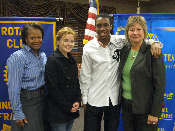 Tinley Park-Frankfort Rotary Club member Wendy Bumphis (left), the assistant principal at Tinley Park High School, and Rotary President Karen Wegrzyn (right) join Tinley Park High School students Rachel Gattone and Ellis Moore for a group photo after a recent Rotary club meeting. The students reported on what they learned at a Rotary Youth Leadership Awards (RYLA) program in Lake Geneva.