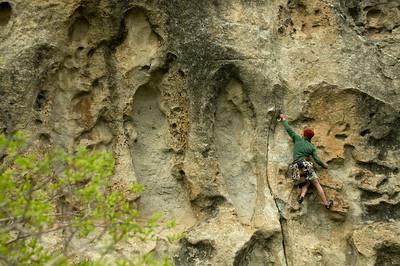 Ryan Minton climbing limestone pockets in the City of Rocks, Idaho.
