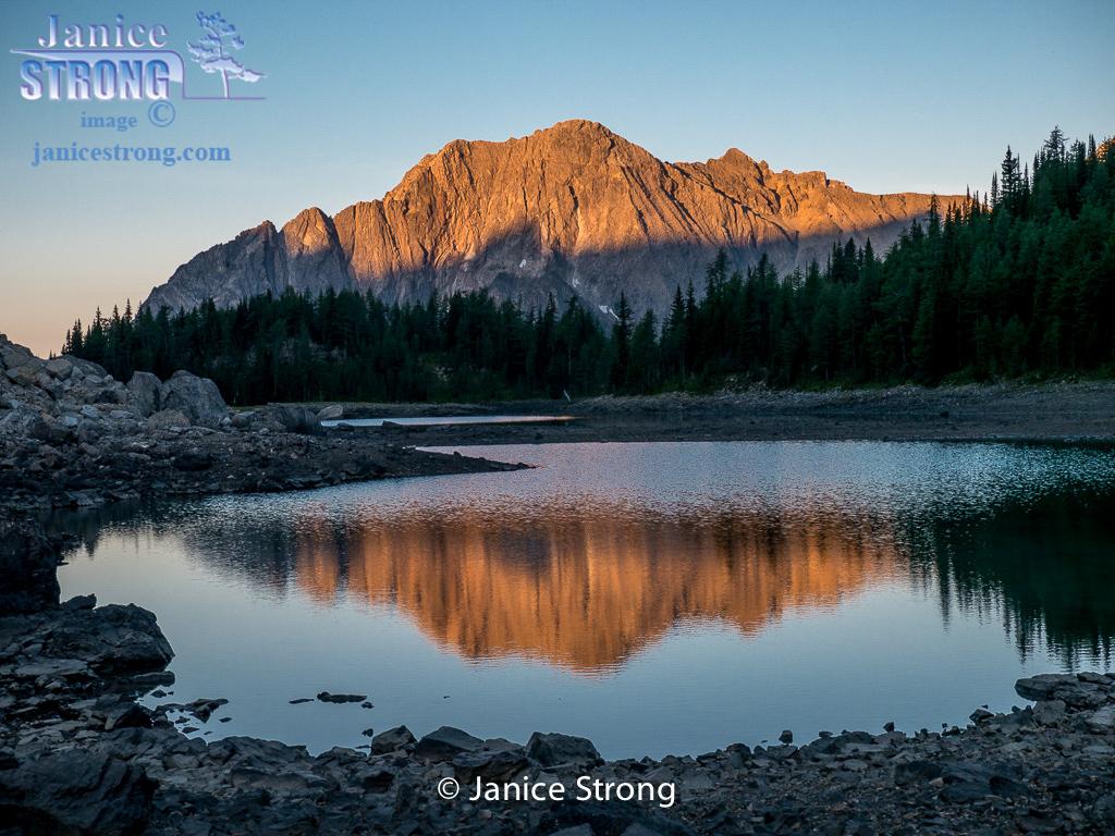 Shanara Lake BC Rockies reflection on an alpine tarn.