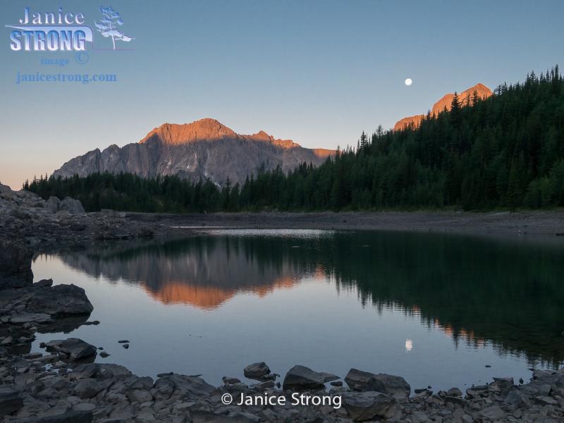 Shanara Lake with full moon setting, BC Rockies.
