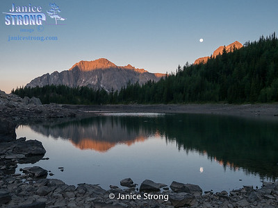 Shanara Lake with full moon setting, BC Rockies.