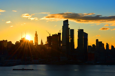 New York Skyline and Rising Sun