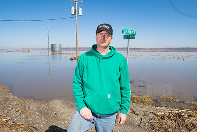 Jeff Jorgenson, a Fremont County Farmer, stands near one of his grain bin sites that was flooded by the Missouri River. Jorgenson considers himself fortunate. he was able to remove the grain before flood waters caused damage. Many area farmers weren't as lucky and have suffered serve losses that aren't covered by insurance policies.