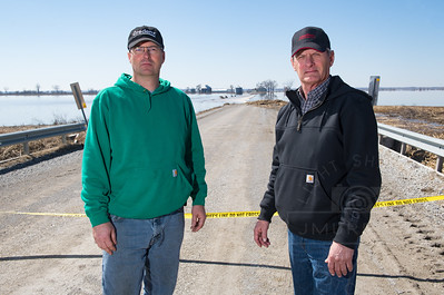 Jeff Jorgenson, and Leo Ettleman, both Fremont County Farmers stand in an area that was flooded by the Missouri River. Jorgenson considers himself fortunate. he was able to remove the grain before flood waters caused damage. Many area farmers, including Ettleman, weren't as lucky and have suffered serve losses that aren't covered by insurance policies.
