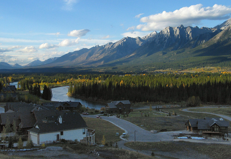 Late-day view of homes nestled in the Bow Valley<br /> Canmore, Alberta, Canada