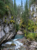 Johnston Creek flowing through Johnston Canyon gorge<br /> Banff National Park, Alberta, Canada