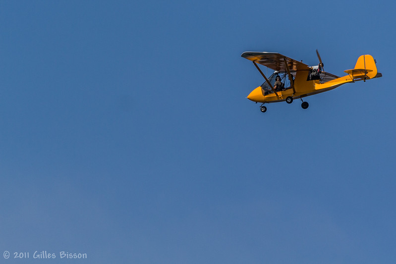 Ultra light airplane flying over West Lake, Aug 27 2011