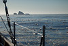 An icy horizon for a small sail boat to find a safe passage through.