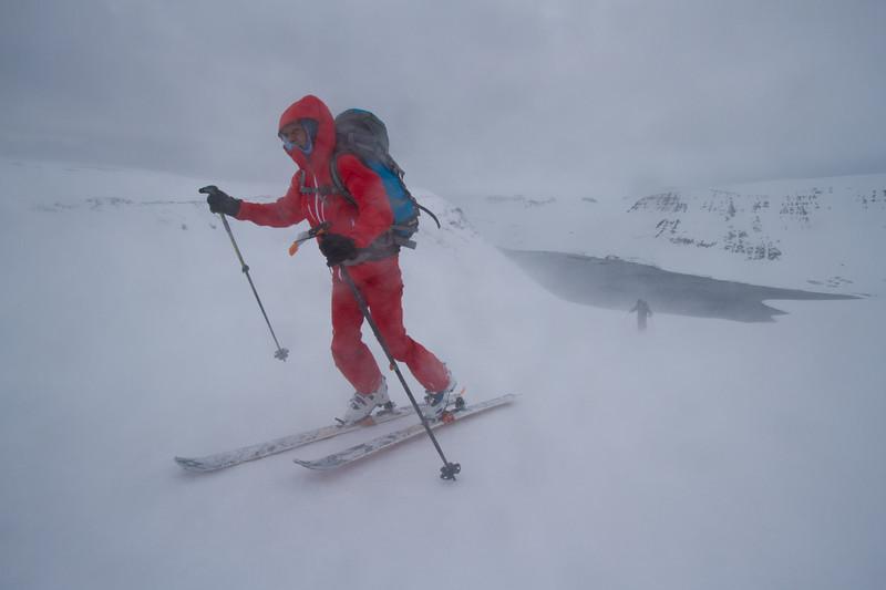Martha Hunt skins in fierce wind in Iceland.