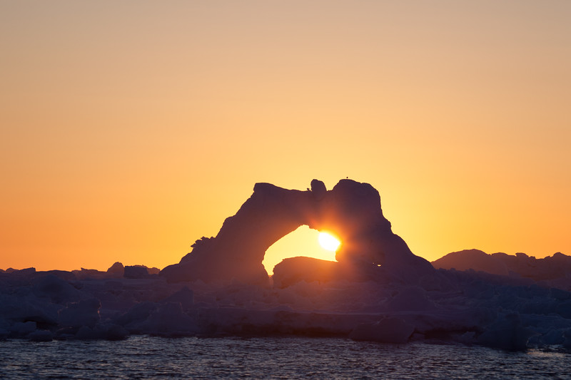 The setting sun among icebergs off the southern tip of Greenland.