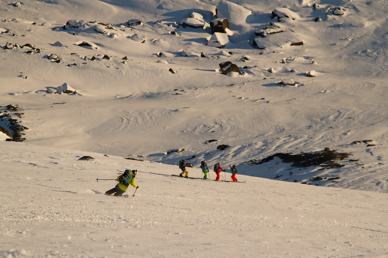 Nat Segal skiing in a remote valley in South Greenland with the rest of the team below.