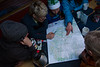 The Shifting Ice team looking at maps planning for the next day's adventure.
