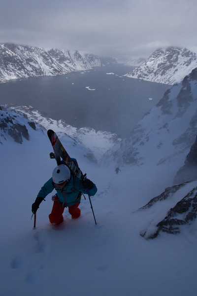 Pip Hunt climbing a ski line in South Greenland.