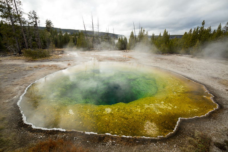 Steam rising above Morning Glory geyser in Yellowstone National Park.
