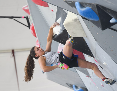 VAIL, CO - JUNE 07: Brooke Raboutou reaches for chalk while climbing the wall during the IFSC Climbing Vail World Cup on June 7, 2019, in Vail, Colorado. (Photo by Joseph L. Murphy/Getty Images Contributor)