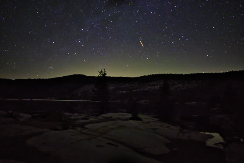 The lights of Lake Tahoe illuminating the night sky over Rubicon Resevoir