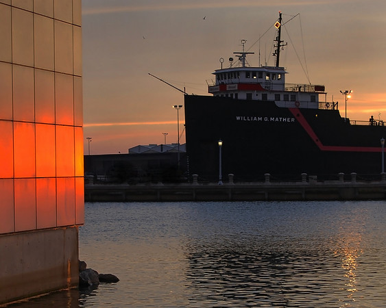 Sunset view of the retired Mather ore boat and a part of the wall of the Rock and Roll Hall of Fame and Museum in Cleveland, Ohio.