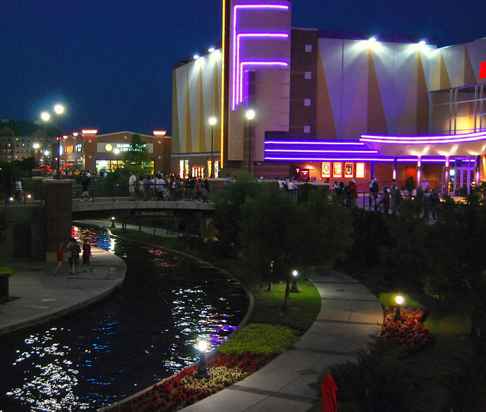 Night view of Oklahoma City's Downtown Riverwalk.