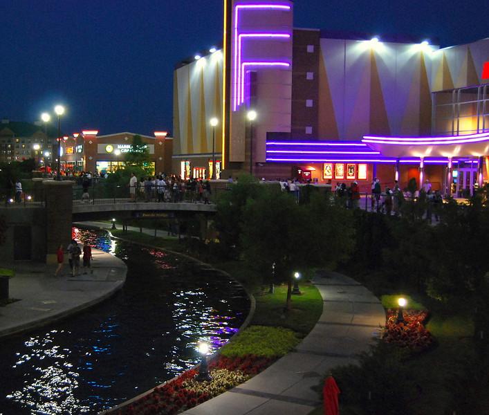 Night view of Oklahoma City's Downtown Riverwalk.