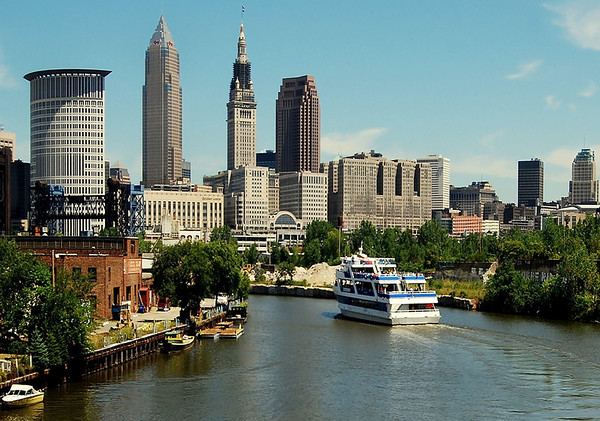 Downtown Cleveland as seen from the Flats along the Cuyahoga River. The boat is the Good Time cruise ship.