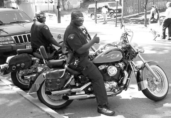 Cleveland police officers on their motorcycles at the Feast of the Assumption in Cleveland's Little Italy.