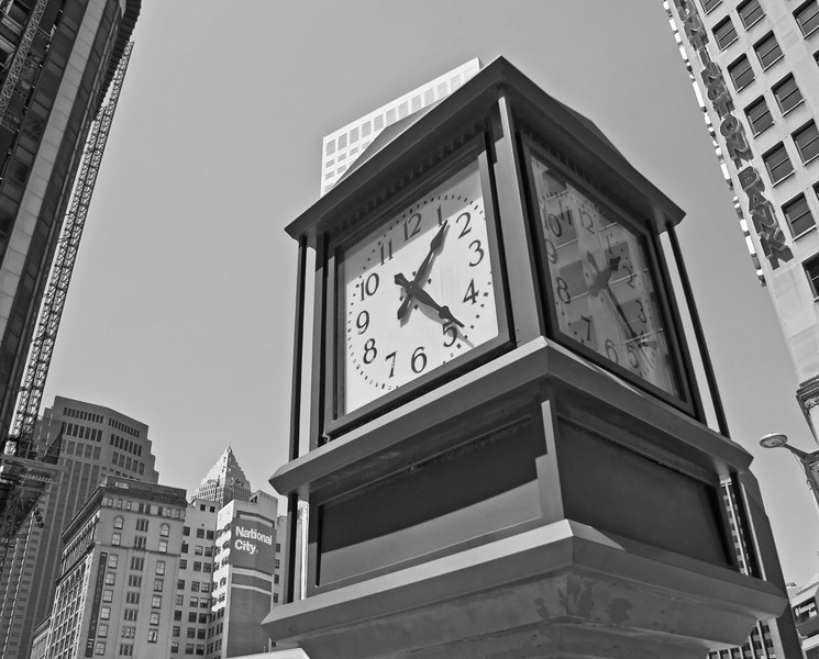 View of the clock found on the southeast corner of East 9th Street and Euclid Avenue in Cleveland, Ohio. The clock was built by the old Cleveland Trust Company.