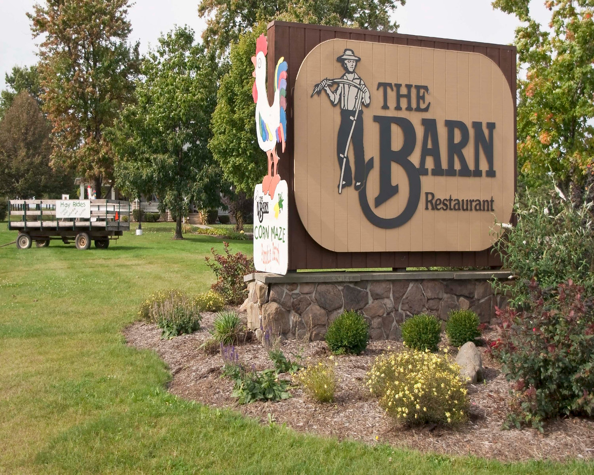 Photo: Front entrance sign for The Barn Restaurant in Smithville, Ohio (Wayne County, Ohio).  Description: Restaurant, retail shops, and banquet facilities exist on the property.  Role in Wayne County's Ag-Bio Cluster: Tourism and travel generator, retail shops, restaurant.  Website: http://www.thebarnrest.com/