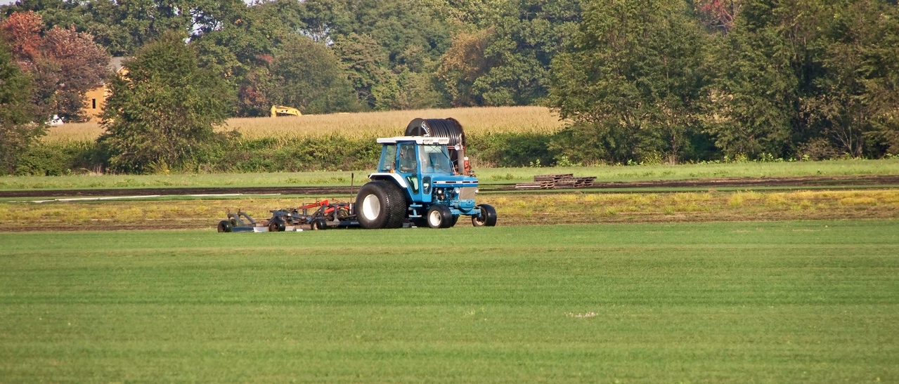 Photo: Tractor working in one of the fields of the Medina Sod Farms located just outside Orrville, Ohio (Wayne County, Ohio).  Role in Wayne County's Ag-Bio Cluster: Sod farmer, landscape design.  Website: http://www.medinasodfarms.com/