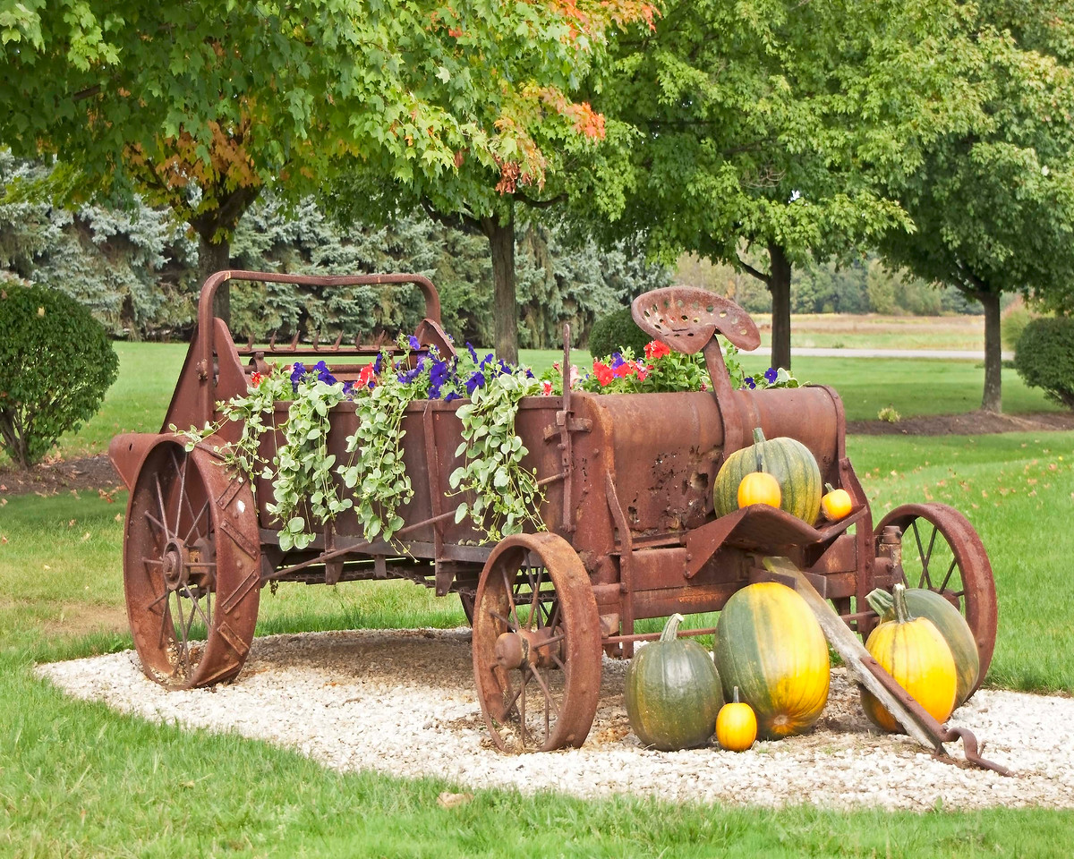 Photo: Old farm vehicle decorated with flowers and pumpkins. Located at The Barn Restaurant in Smithville, Ohio (Wayne County, Ohio).  Description: Restaurant, retail shops, and banquet facilities exist on the property.  Role in Wayne County's Ag-Bio Cluster: Tourism and travel generator, retail shops, restaurant.  Website: http://www.thebarnrest.com/