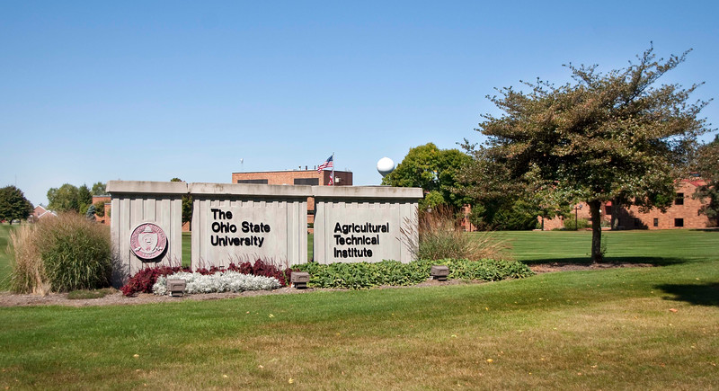 """Photo: Front entrance sign. Agricultural Technical Institute (ATI) of The Ohio State University. <br /> <br /> Description: Located in Wooster, Ohio, ATI is an associate degree-granting program within the College of Food, Agricultural, and Environmental Sciences at The Ohio State University. Students participate in a curriculum that includes general and basic studies, hands-on experience and a paid industry internship. Ohio State ATI is the largest institution of its kind in the U.S., enrolling approximately 800 students and offering 28 programs of study. Ohio State ATI maintains a 99 percent job placement rate for all graduates within four months of graduation. Ohio State University's Ohio Agricultural Research and Development Center is adjacent to the campus.<br /> <br /> Role in Wayne County's Ag-Bio Cluster: Higher education leader, travel and tourism generator, workforce training related to horticulture, floral design and marketing, beef and cattle production, crop management, environmental resource management, greenhouse management, horse production and management, landscape design, nursery management, swine production and management, and various aspects of business related to agriculture.<br /> <br /> Website: <a href=""""http://ati.osu.edu/"""">http://ati.osu.edu/</a>"""