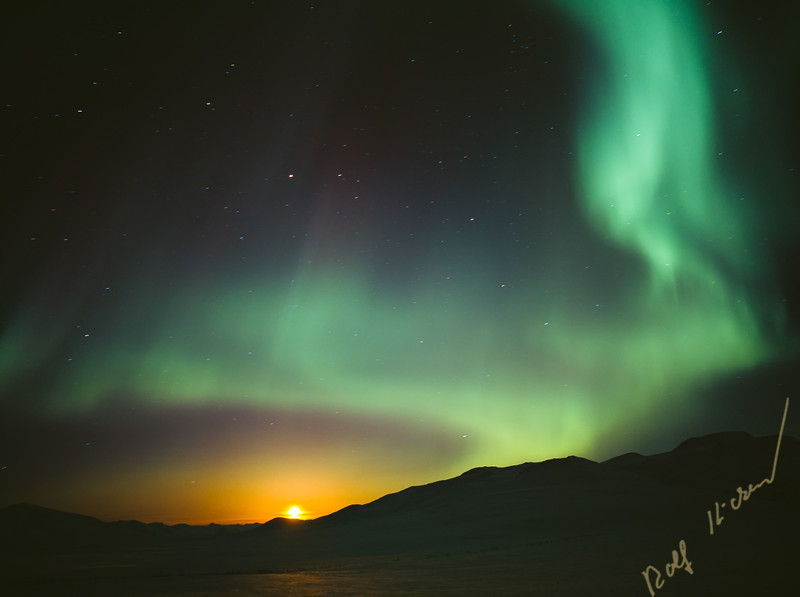 Moonrise with northern lights over Chandalar Shelf, Brooks Range, Alaska, USA
