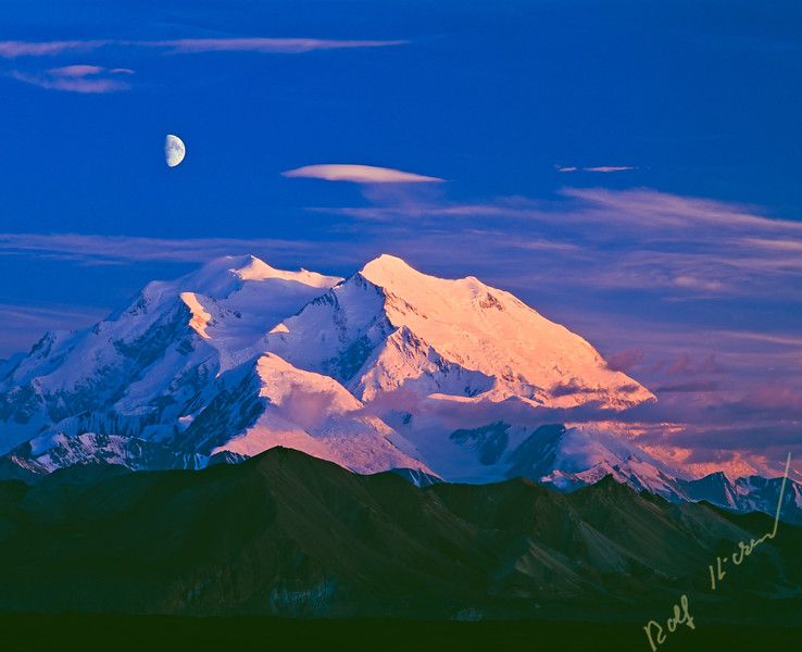 Mount McKinley (Denali) with a half moon at dawn and dusk, twilight, in Denali National Park and Preserve, Alaska, USA.