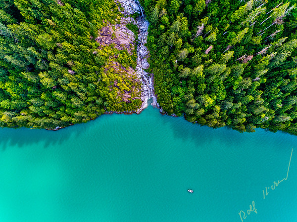 """Aerial photograph of a non name waterfall and the """"Ambient Light"""" tour boat in Knight Inlet, First Nations Territory, British Columbia, Canada."""