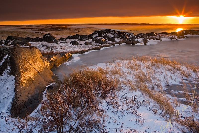 Sunset over the rocky coastline of Hudson Bay, Churchill, Manitoba, Canada.