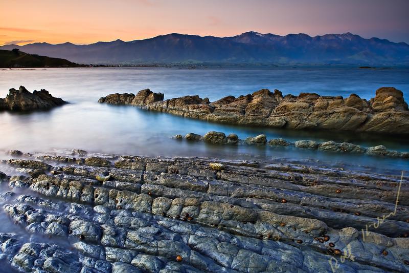 Sunset on the Kaikoura Peninsula near the Seal Colony looking towards the Kaikoura Mountain Range, Kaikoura, East Coast, South I