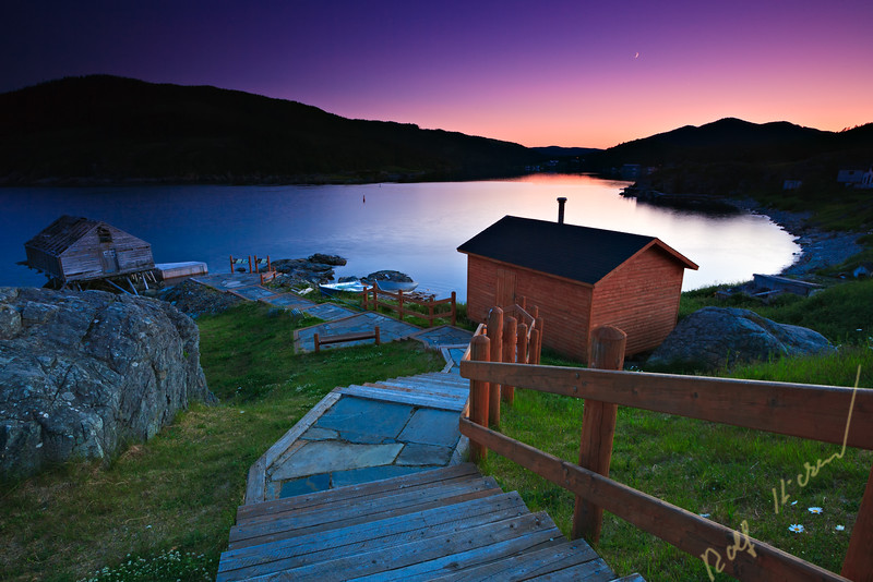 Steps leading down towards a shed at a picnic reserve during sunset in the town of Fleur de Lys, Dorset Trail, Highway 410, Baie Verte Peninsula, Newfoundland, Newfoundland Labrador, Canada.