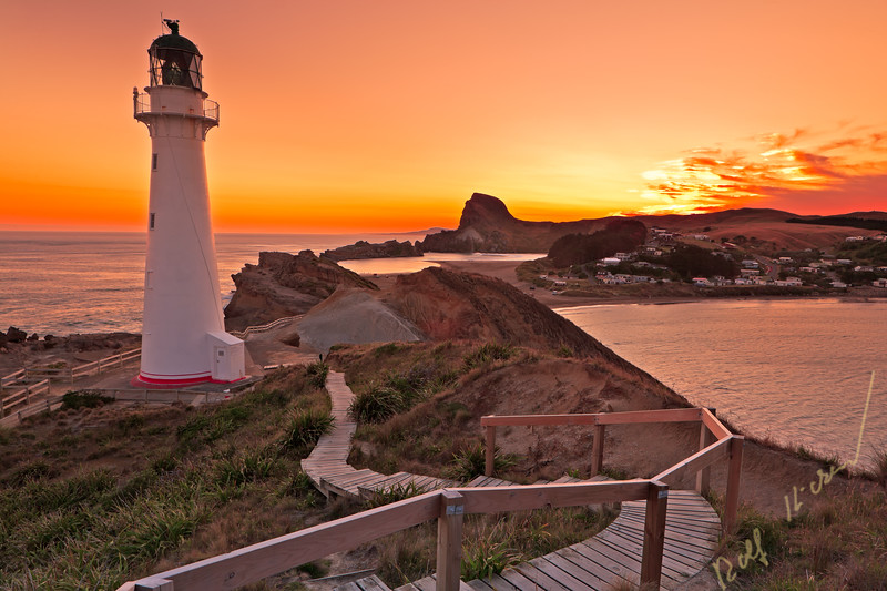 Sunset at Castlepoint Lighthouse which overlooks the lagoon and bay, Castlepoint, Wairarapa, North Island, New Zealand.