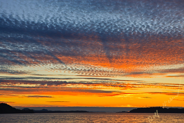 Sunset with dramatic clouds over Alert Bay, Cormorant Island, Broughton Strait and Vancouver Island