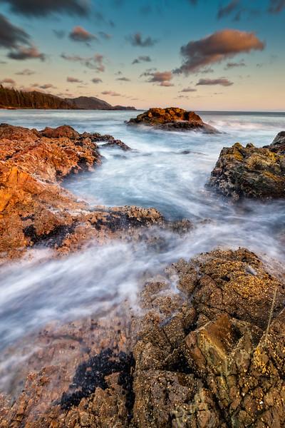 Wild West Coast of Northern Vancouver Island, Cape Scott, British Columbia, Canada. Waves crashing along coastline photographed in long exposure.
