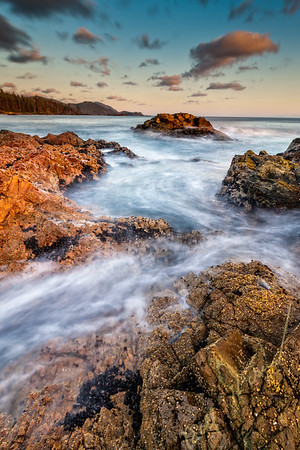 Wild West Coast of Northern Vancouver Island, Cape Scott, British Columbia, Canada. Waves crashing along coastline photographed in long exposure.