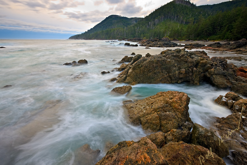 Rugged coastline and wave action along the West Coast at Cape Palmerston, Northern Vancouver Island, Vancouver Island, British Columbia, Canada.